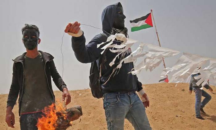 حريق في إسرائيل بسبب قنبلة مولوتوف مثبته بطائرة ورقية اطلقت من غزة