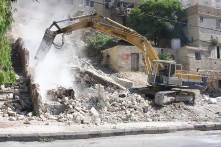 بالصور..ازالة 13 مبنى مهجور آيل للسقوط في العاصمة عمان