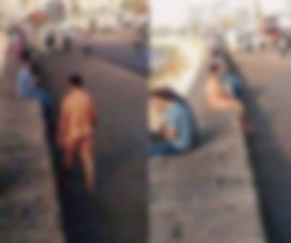 رجل عارٍ جالس وسط مدينة عربية قرب امرأة محجبة ! بالصور