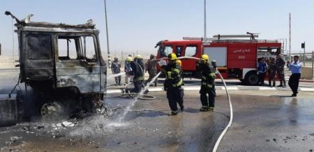 بالصور ... الاحتلال يشارك في اخماد حريق بالأردن