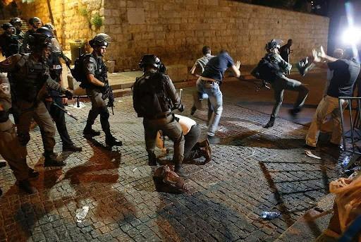اشتباك مسلح في جنين وحملة مداهمات واعتقالات واسعة في الضفة