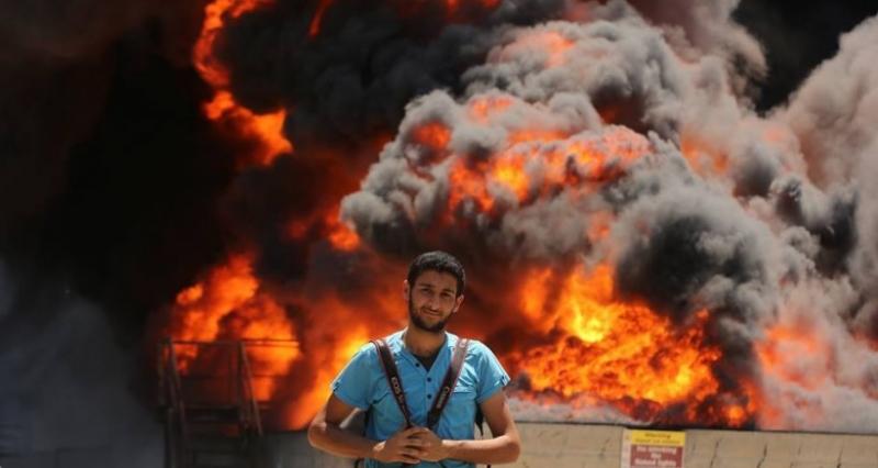 صحفي من غزة يفوز بجائزة لقب مصور عام 2015 في الشارقة